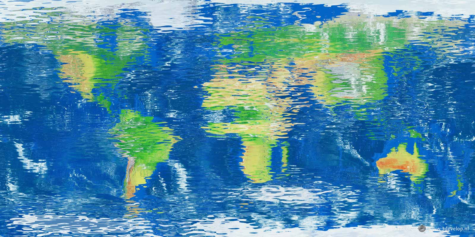 World map mirrored in a reflective and slightly undulating water surface