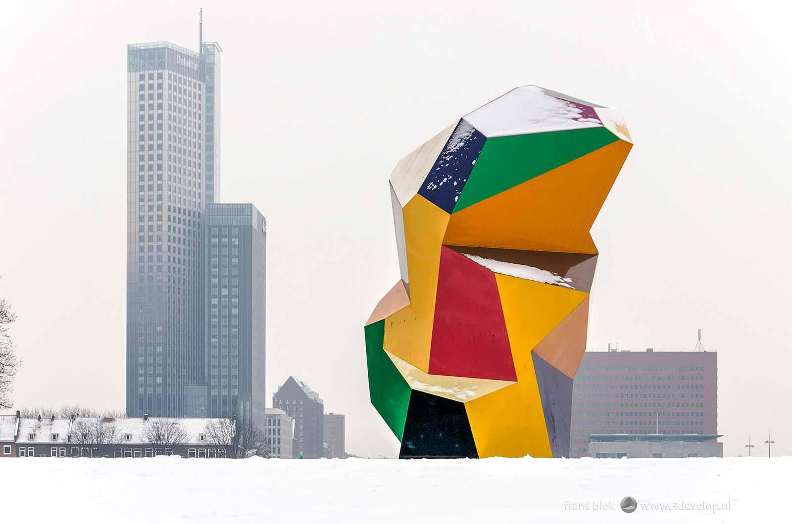 The colorful Marathon sculpture near Erasmusbridge in Rotterdam is a striking contrast with freshly fallen snow
