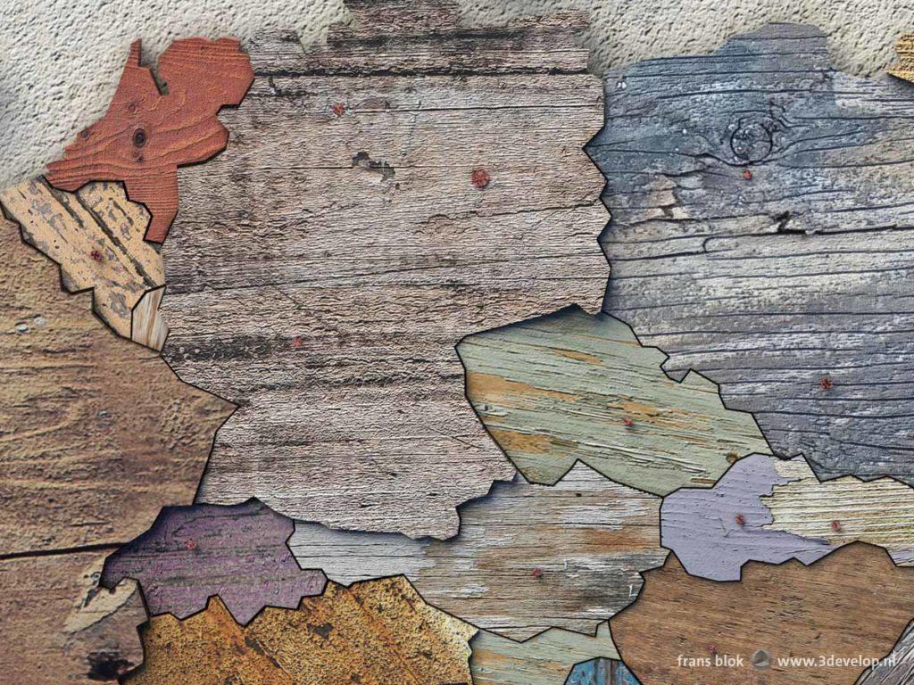 Detail van de sloophoutkaart van Europa met ieder land opgebouwd uit verschillende stukken digitaal gerecycled hout