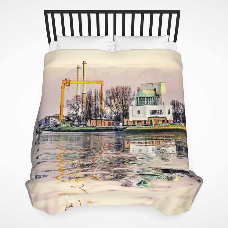 Duvet cover with a print of a surrealistic image of the Maastunnel ventilation building in Rotterdam reflecting in the river Nieuwe Maas at sunset