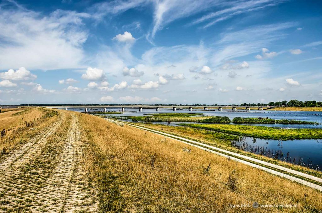 View from the new dike towards Nieuwendijkbrug across Reevediep canal on a summer day