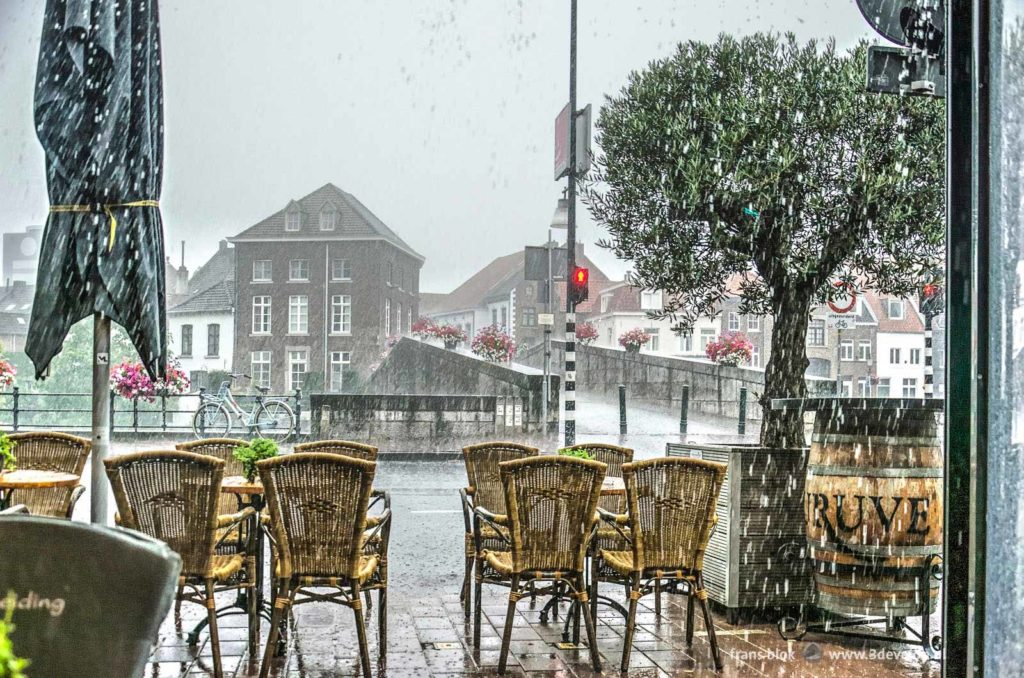 Cloudburst seen from the terrace of a cafe near the Stone Bridge in Roermond, The Netherlands