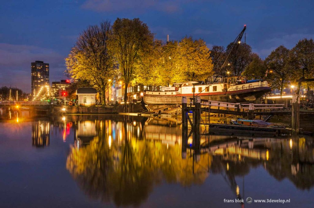 De Koningswerf (Kings Wharf) historic shipyard at the Old Harbour in Rotterdam, The Netherlands, on a windless autumn evening in the blue hour