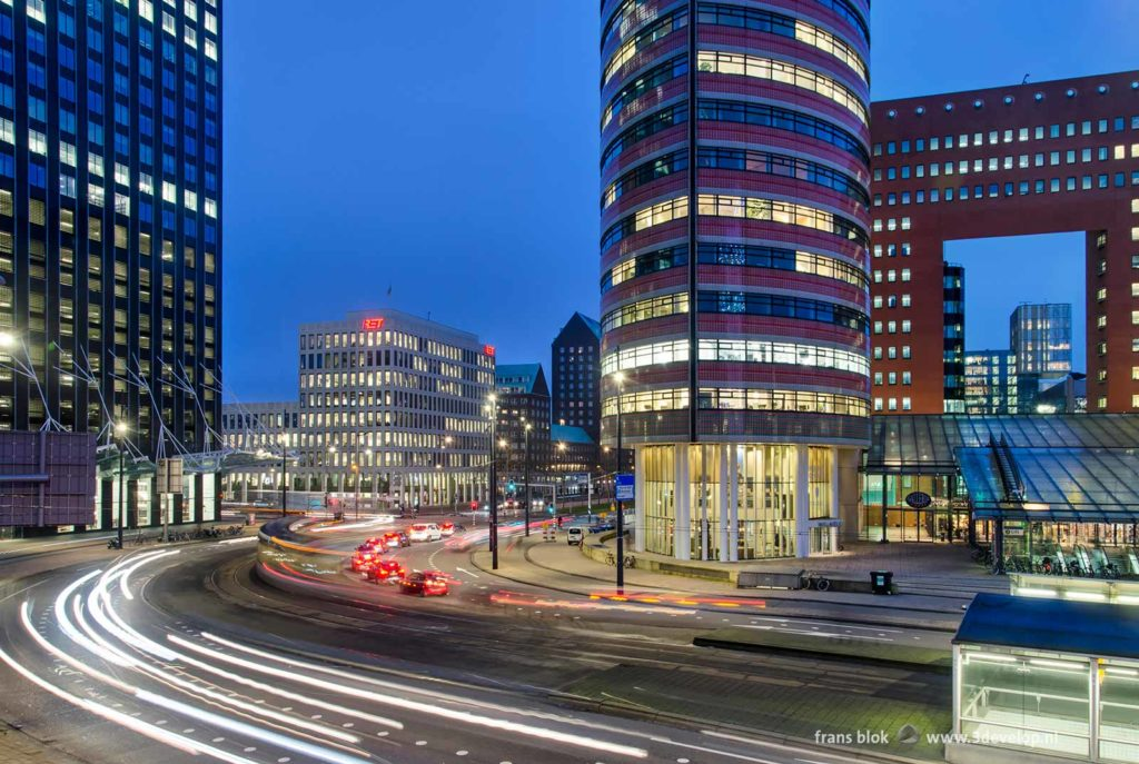 Morning rush hour at Kop van Zuid district in Rotterdam, surrounded by modern architecture, during the blue hour on a January morning