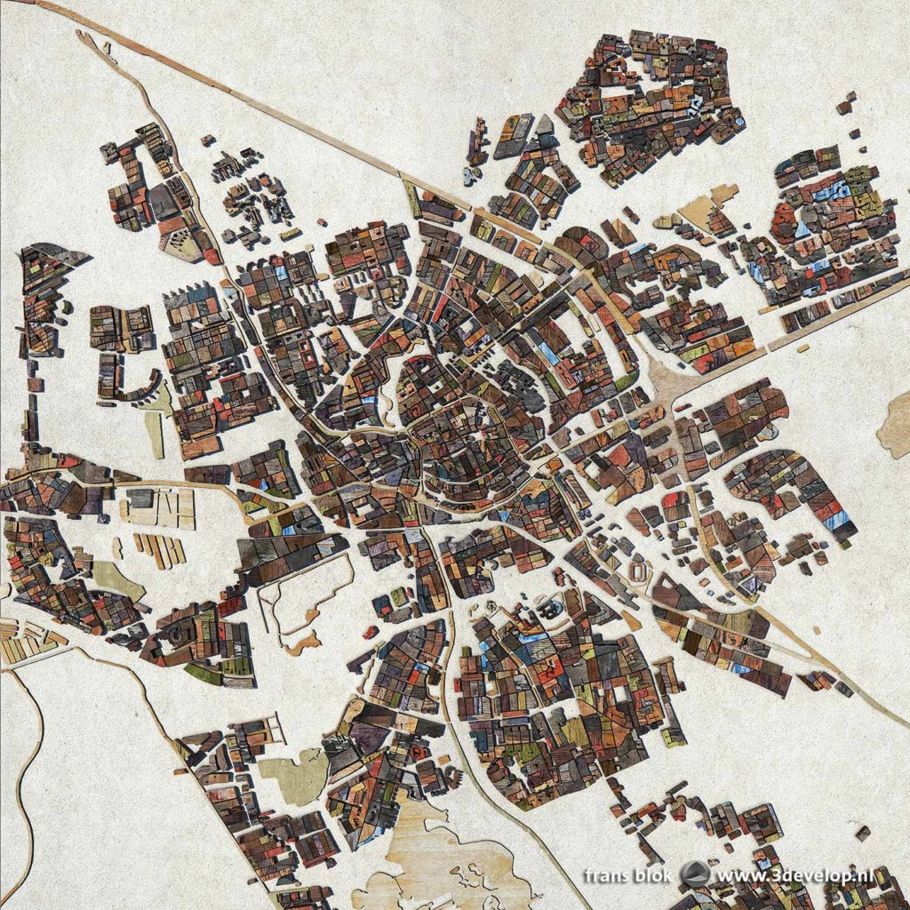 A map of the city of Groningen, the Netherlands, with city blocks and canals rendered as digital scrapwood and plywood