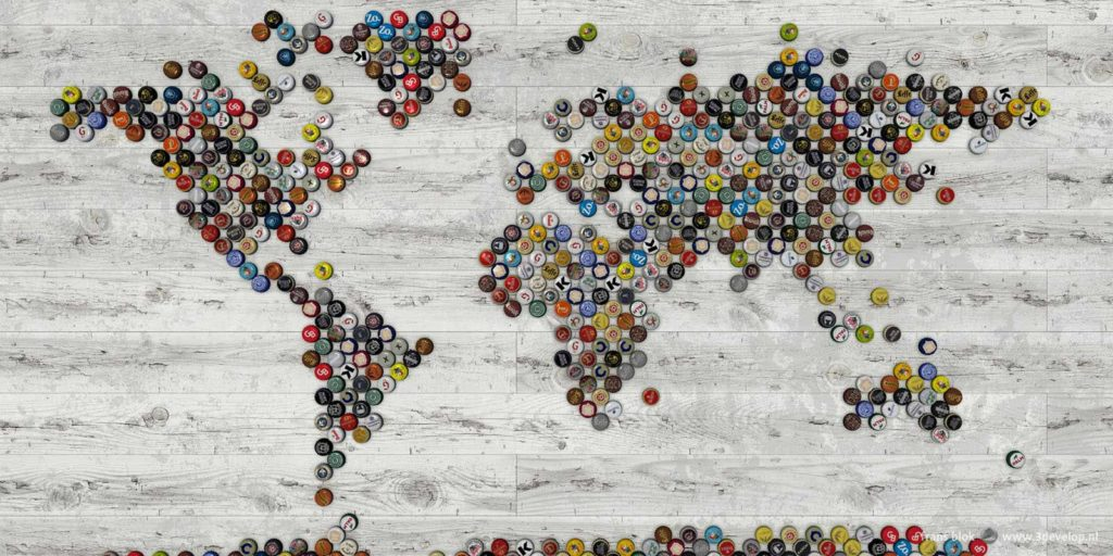 World map made of bottle caps of 54 different beers from Belgium and The Netherlands on a white wooden floor
