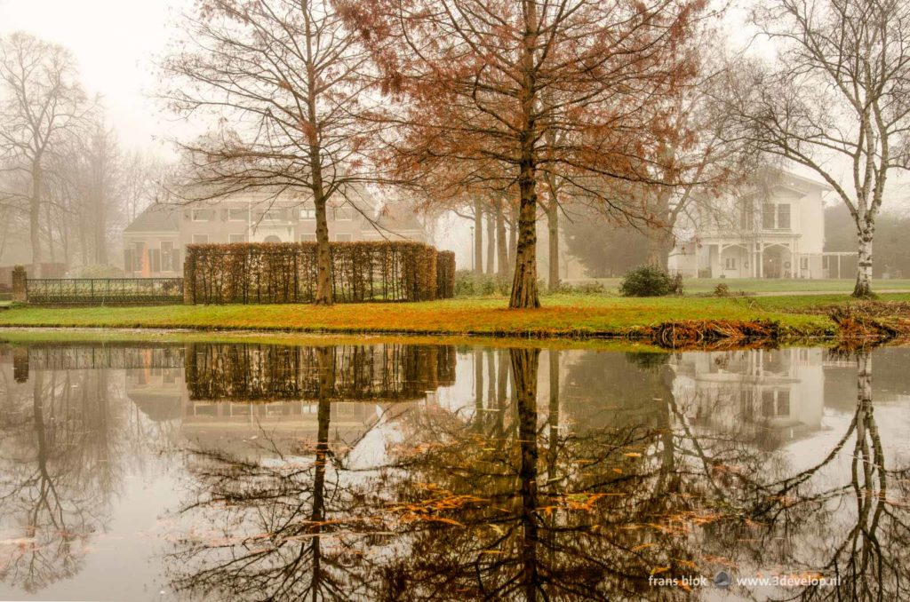 The Mansion and the coach House in The Park in Rotterdam, The Netherlands on a foggy day in late autumn