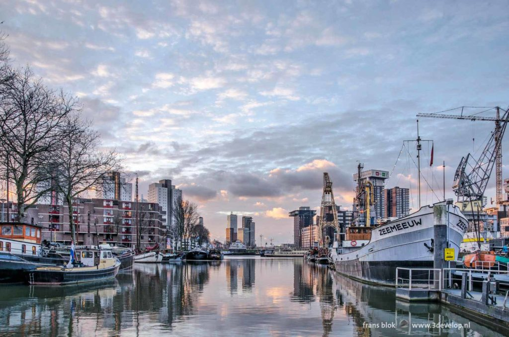 Beautiful sky shortly after sunrise over Maritime Oudoor Museum in Leuvehaven harbour in Rotterdam, The Netherlands