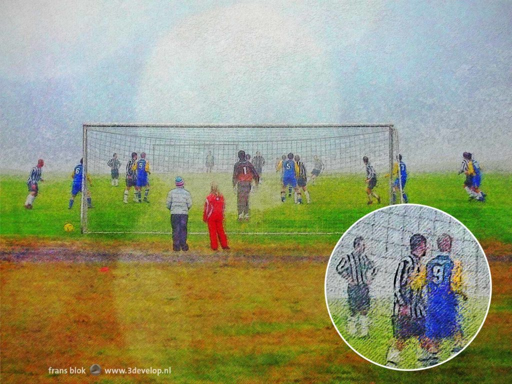 Picturesque impression of a football/soccer match on a misty day in Djupivogur, Iceland