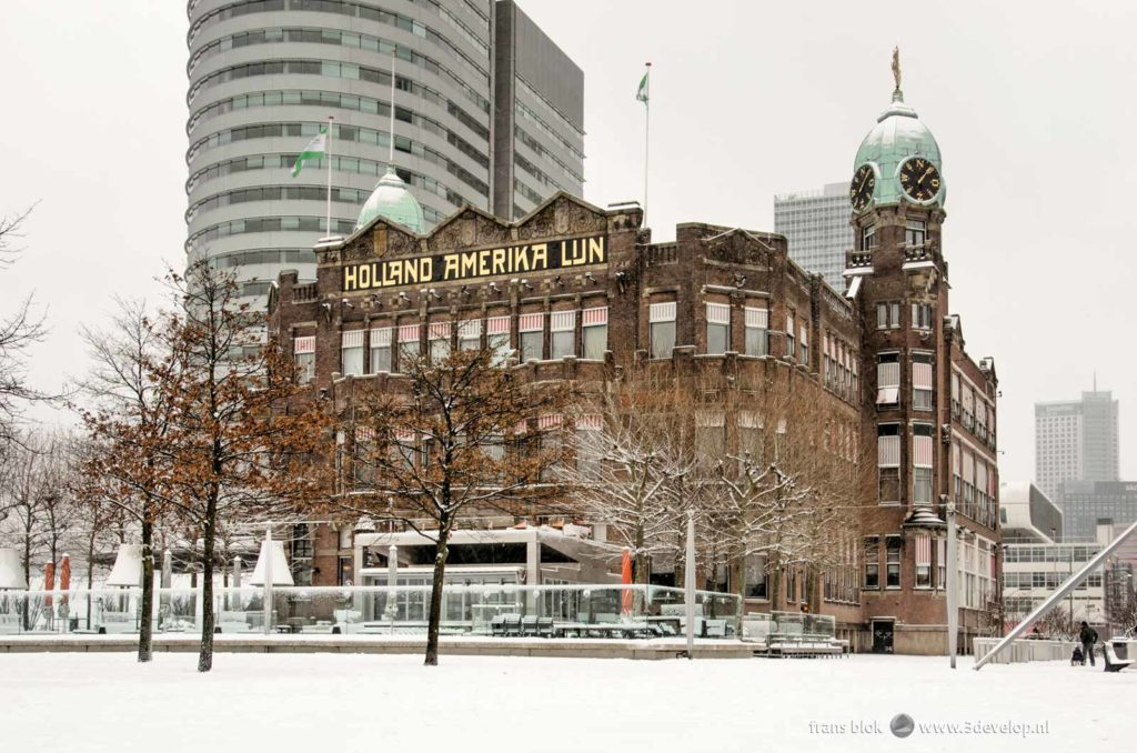 Hotel New York on Wilhelminapier in Rotterdam, surrounded by and covered under a layer of fresh snow in the winter of 2021