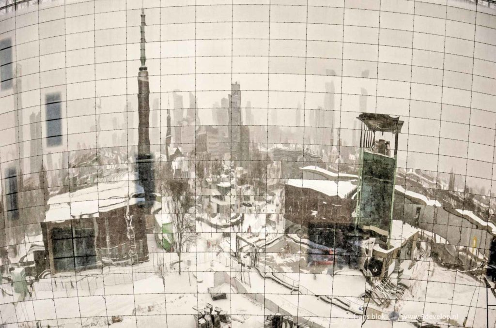 The city of Rotterdam, covered with snow in the winter of 2021, reflecting in the mirror facade of the new depot of the Boymans museum