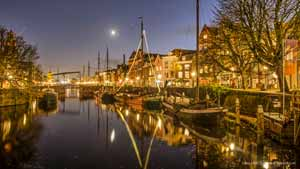 Photo of Aelbrechtskolk canal in Delfshaven, Rotterdam, The Netherlands, in the blue hour after sunset