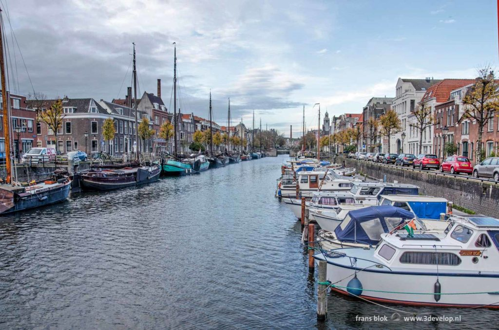 Historic inland barges and modern yachts on Voorhaven canal in Delfshaven, Rotterdam, The Netherlands