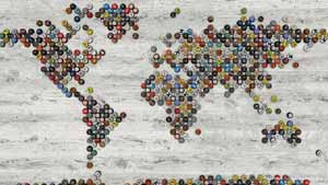 World map of beer bottle caps on a white wooden floor